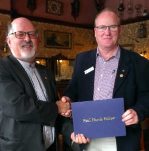 The Hon Rob Valentine MLC being congratulated by Rotary Club of Sullivan's Cove President Mr Peter Gibson on being awarded a Paul Harris Fellow